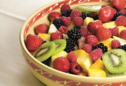 An image of a healthy fruit slaad, with strawberries, blackberries, raspberries, pineappe, and kiwi.