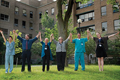 Sunnybrook staff cheering and holding hands