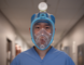 Dr. Brian Li wears a full-faced snorkel mask being designed as a N95 alternative