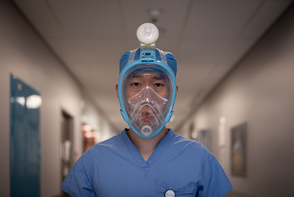 A Sunnybrook employee wearing a mask.