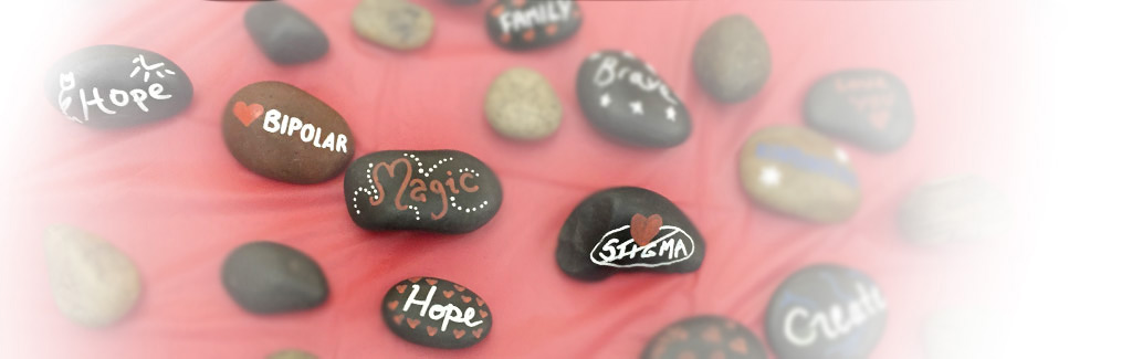 Painted stones with words of inspiration and hope