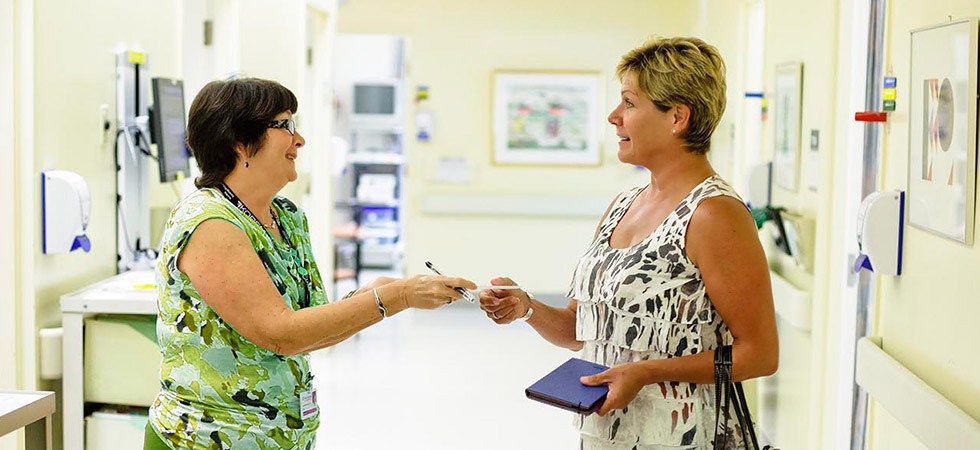 Sunnybrook staff members helps a visitor