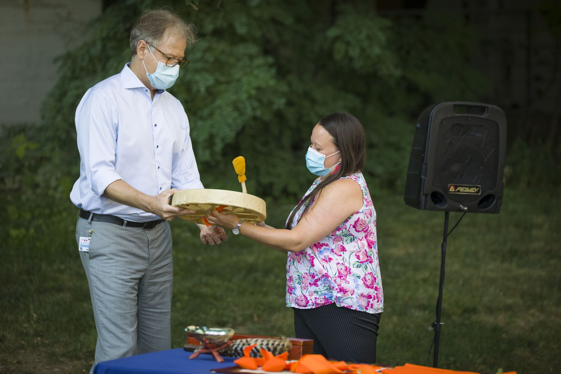 After awakening the drum, Claire Dion Fletcher passes the drum to Dr. Andy Smith.