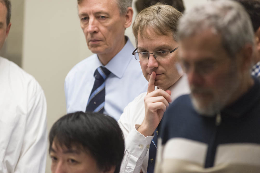 Group of researchers watch monitor