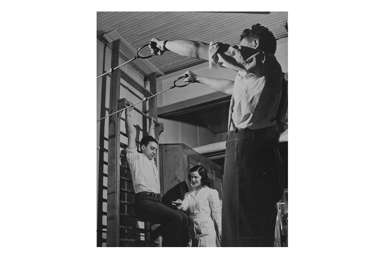 Veterans performing rehabilitation exercises. 1950-60.