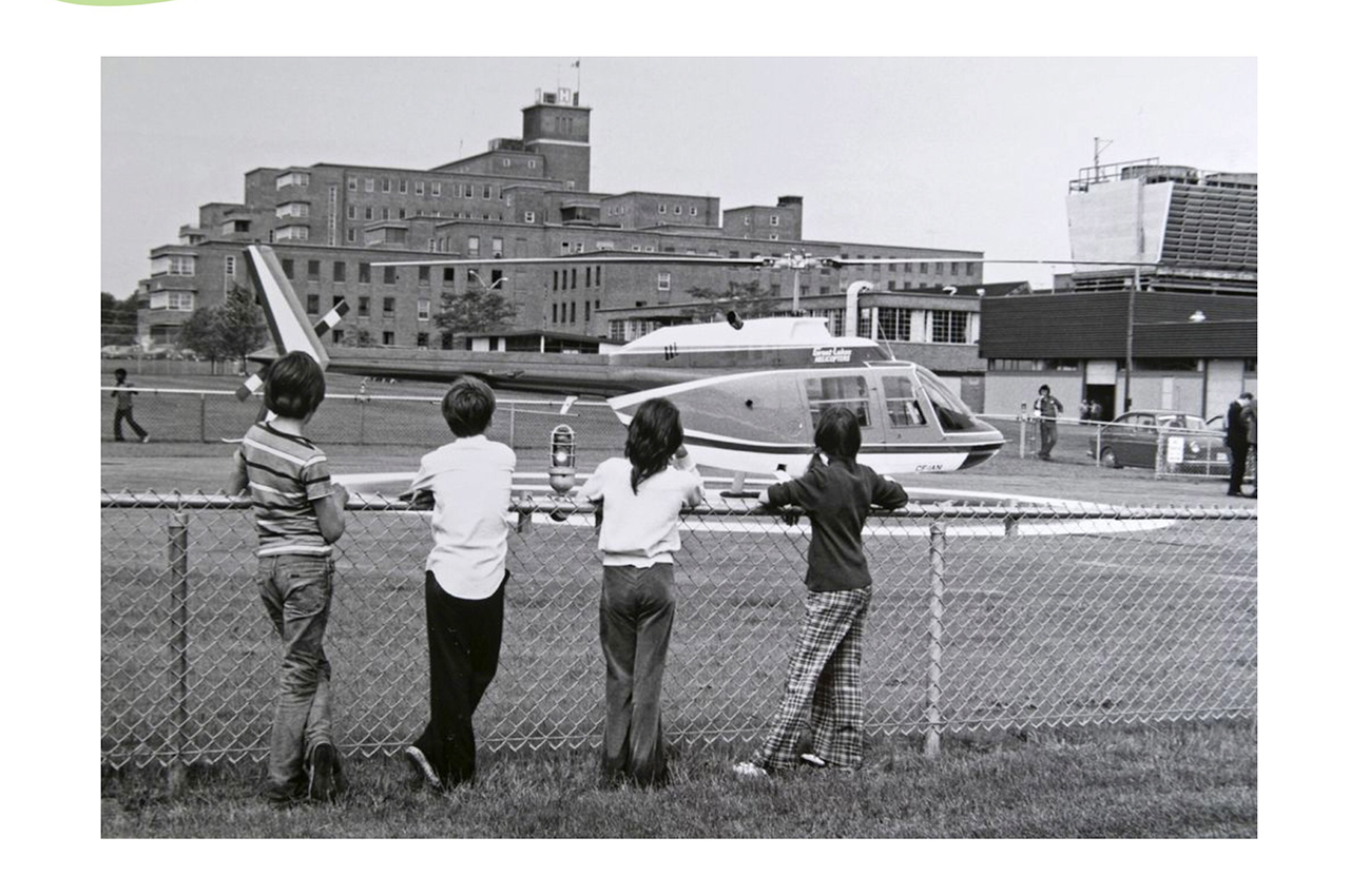 Kids watching air ambulance. 1970-80.