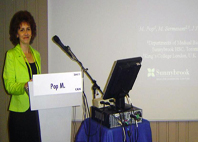 Dr. Mihaela Pop speaks at a conference.