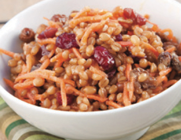 A wheat berry salad with wheatberry, carrot shavings, raisins and dried cranberries.