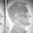 An xray of an American penny, with Abraham Lincoln's profile showing