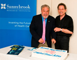Dr. Yaffe and Michael Julius cut a cake in honour of the event