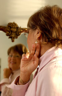 Woman looking at herself in a mirror